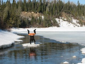 Its all fun and games until somebody gets wet!  Hopefully the Pontax will be more solidly frozen than this March, 2010 waterway!