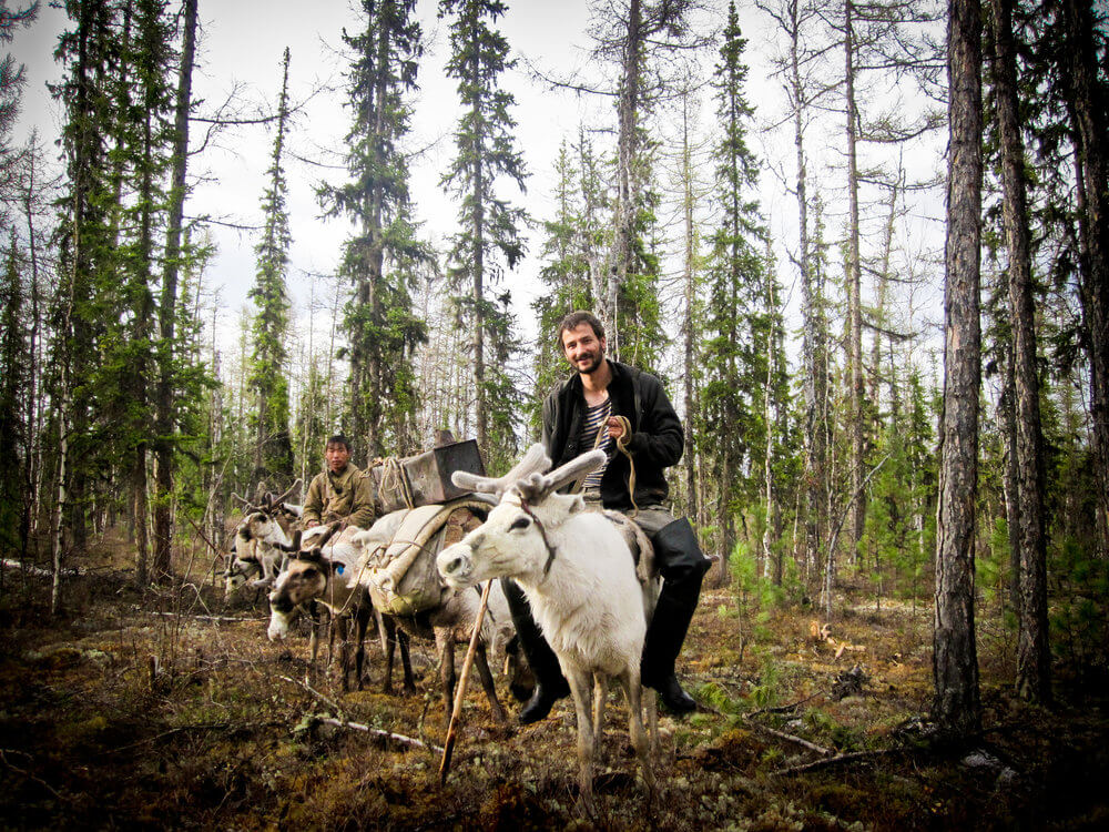 Jordan riding reindeer in Siberia